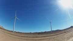 Rotating Electricity Producing Wind Turbines With Sun Stock Footage
