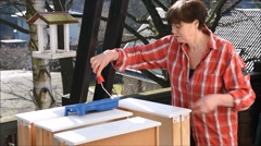 Woman painting furniture Stock Footage