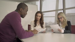 Three Professionals in a Meeting (4 of 6) Stock Footage