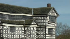 Elizabethan Tudor hall mansion black and white chequered Stock Footage