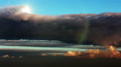 Stock Video Footage of Beautiful skyscape. The sun behind the clouds.