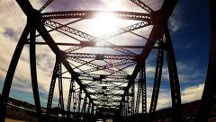 Low Angle POV Driving Under Old Style Bridge Trusses With Sun- Slow Stock Footage