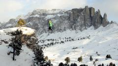 Aerial shot of man almost falling from rope in the mountain Stock Footage