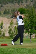 Female golfer - stock photo