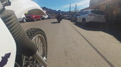 Low Angle View Of Motorcycle Thru Oatman Arizona Stock Footage