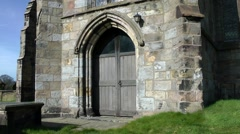 Old church doorway stone wood doors Stock Footage