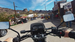 Motorcyclists View Driving Main Street Oatman Arizona Stock Footage