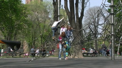 Children Playing playground in park on ropes Stock Footage