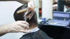 Coiffeur cut male hair Stock Footage