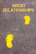 Yellow footsteps on sidewalk towards Great Relationships message - stock photo