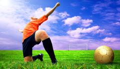 Stock Photo of Happiness footballer - outdoor