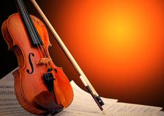 Musical instrument - violin and notes - stock photo