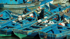 Essaouira boats fisherman morocco coast town tourist Stock Footage