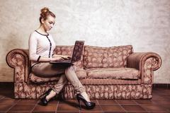 Business woman using computer. Internet home technology. Vintage photo. - stock photo