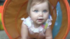 Baby crawls through play tunnel 02 Stock Footage