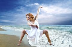 Stock Photo of Woman dancer posing on the beach