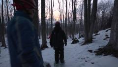 Snowshoeing past camera Stock Footage