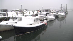 Fishing Boat at a dock in a  Snowstorm Stock Footage