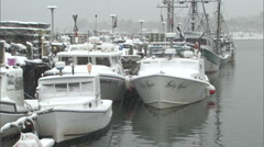 Lobster Boats at a dock in a  Snowstorm - stock footage