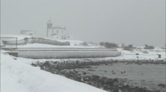 Winter snowfall and lighthouse Stock Footage