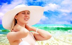 Stock Photo of Young beautiful women on the sunny tropical beach in bikini