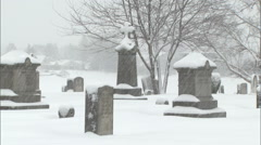 Graves in snowfall Stock Footage