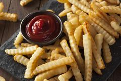 Unhealthy Baked Crinkle French Fries Stock Photos
