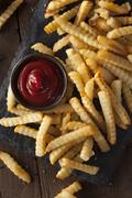 Stock Photo of Unhealthy Baked Crinkle French Fries