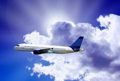 Stock Photo of Airplane on blue sky