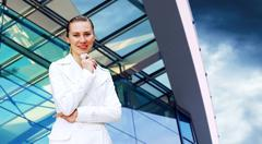 Stock Photo of Happiness businesswoman on the business architecture background
