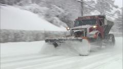 Snowplow passes by in Winter Storm Stock Footage