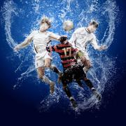 Water drops around football players under water on blue backgrou - stock photo