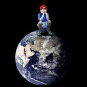 Stock Photo of Child football player on the planet
