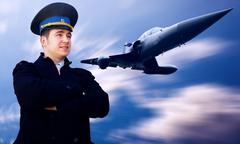 Stock Photo of Pilot and military airplan on the speed