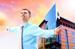 Stock Photo of Hapiness Businessman standing on the business background