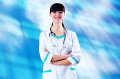 Stock Photo of Smiling medical doctor with stethoscope on the hospitals backgro