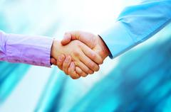 Stock Photo of Shaking hands of two business people