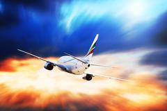 Airplane at fly on the sky with clouds Stock Photos