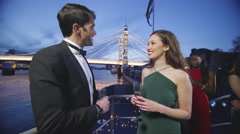 4K Attractive couple chatting on boat deck during party at night Stock Footage