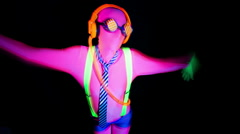 Ultra violet disco glow sexy gogo female dancer raver Stock Footage