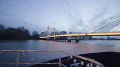 4K The Albert Bridge at dusk, Chelsea Harbour, London - stock footage
