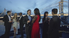 4K Attractive diverse group socializing at boat party on the River Thames Stock Footage