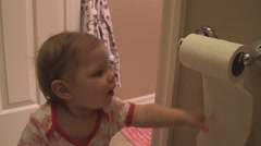 Baby plays with toilet paper roll 02 Stock Footage