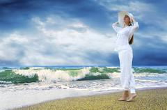 Young beautiful women in the white on the  beach Stock Photos