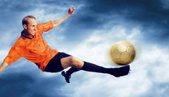 Stock Photo of Shoot of football player on the sky with clouds