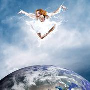 Stock Photo of Jump of ballerina with dress of milk