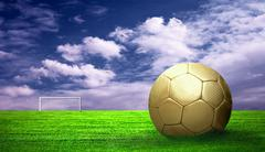 Soccer ball on green grass and sky background - stock photo