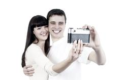 Stock Photo of Young beauty couple with photo camera isolated on white backgrou