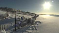 Winter Beach snow fence and sunrise Stock Footage