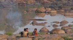 Boys around a fire near Tad Lo,Tad Lo,Laos Stock Footage